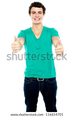 Guy showing thumbs up, arms stretched out. Isolated over white - stock photo