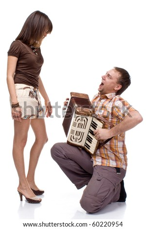 guy sings a song for a girl on white background - stock photo