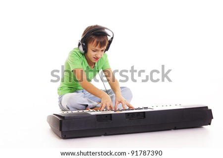 guy sitting on the floor with a synthesizer - stock photo