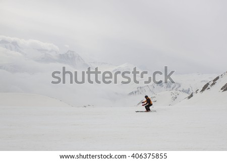 guy skiing down the mountain
