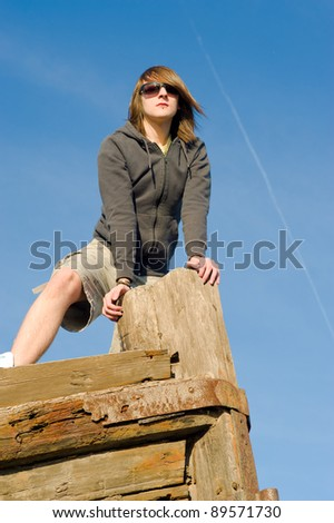 Guy standing on a vessel prow, a concept - stock photo