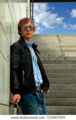 guy standing on the steps in glasses and jacket