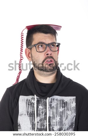 Guy surprised with telephone on head