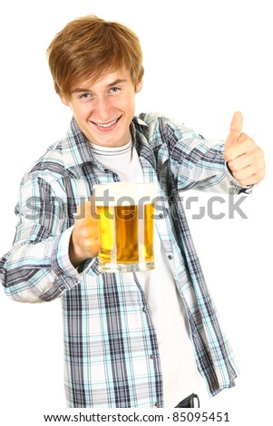 guy toasting with a glass of cold beer - stock photo