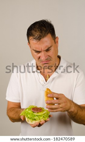 Guy unhappy with his far too light burger full of veggies