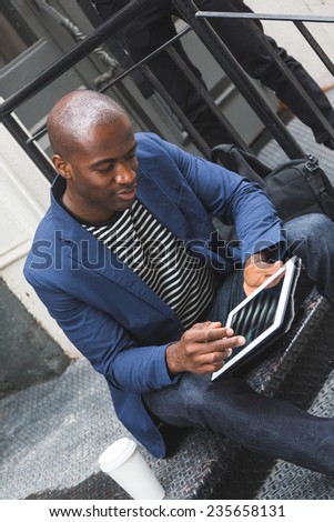 Guy Using Digital Tablet - stock photo