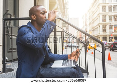 Guy Using Notebook in New York - stock photo