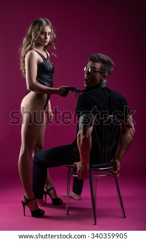 Guy was caught on submission to sexy stripteaser - stock photo