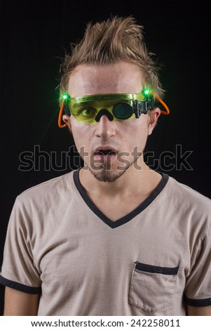 Guy wearing toy glasses. - stock photo