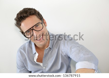Guy with eyeglasses standing on white background