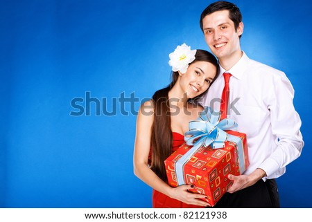 guy with girl are holding box with gift - stock photo