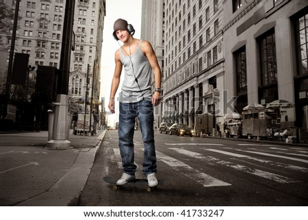 guy with headphones in a city street