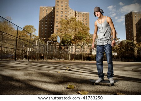 guy with headphones in a city street - stock photo
