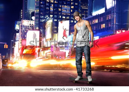 guy with headphones in Time Square - stock photo