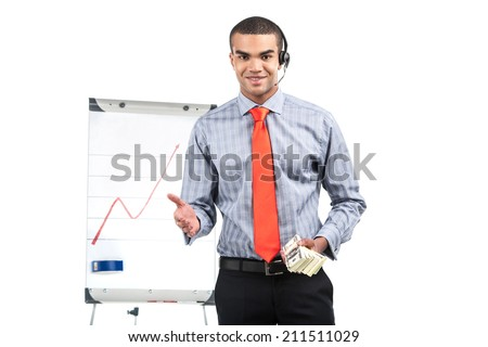 guy with presentation gesturing with hands. waist up of african man standing in red tie and holding money - stock photo