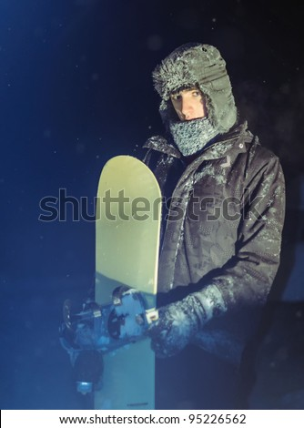 Guy with snowboard - stock photo