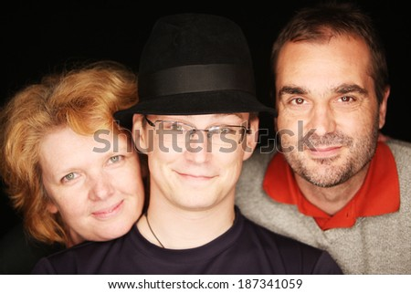 Guy with the hat with his parents (focus on the guy in the middle) - stock photo