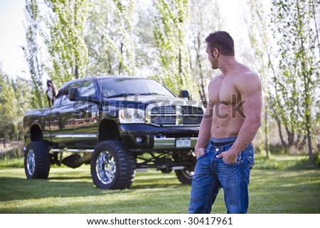 Guy with truck with pit bull - stock photo