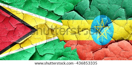 Guyana flag with Ethiopia flag on a grunge cracked wall - stock photo