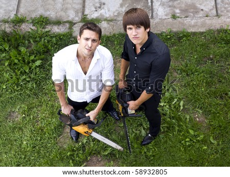 guys with chainsaws - stock photo