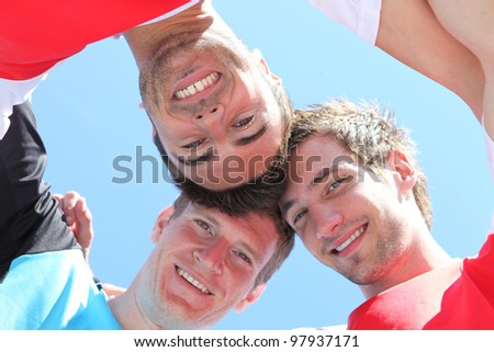 Guys with heads together - stock photo