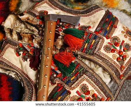 guzul hatchet and traditional waistcoat - stock photo