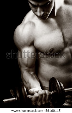 Gym and fitness concept - bodybuilder and dumbbell over black - stock photo