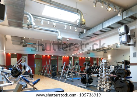 Gym and fitness - weights and equipment, nobody to be seen - stock photo