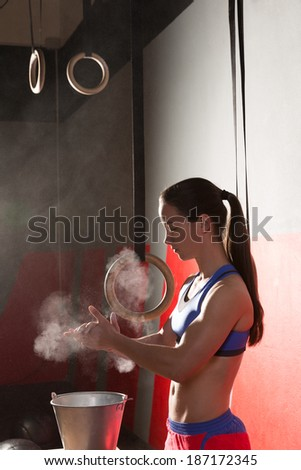 Gym Chalk Magnesium Carbonate hands clapping woman for climbing workout - stock photo