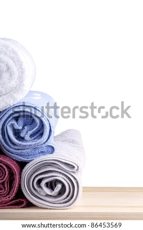 Gym concept - Freshly washed rolled towels isolated on white - stock photo