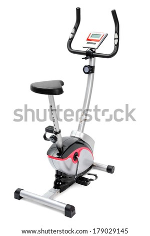 gym equipment, spinning machine or inddor bike for cardio workouts - stock photo