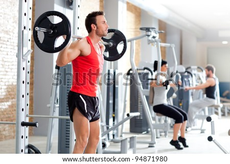 Gym fitness club indoor with young people training weights - stock photo