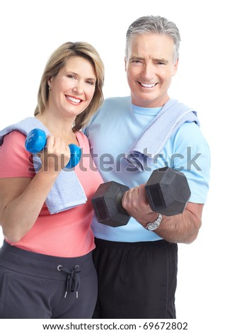 Gym & Fitness. Smiling elderly couple with dumbbells. Isolated over white background - stock photo