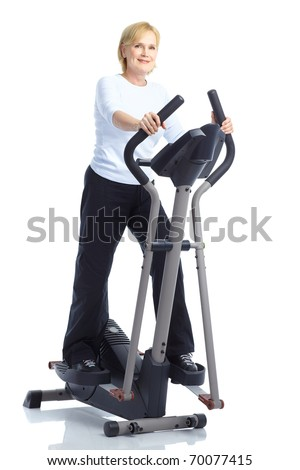 Gym & Fitness. Smiling elderly woman working out. Isolated over white background - stock photo