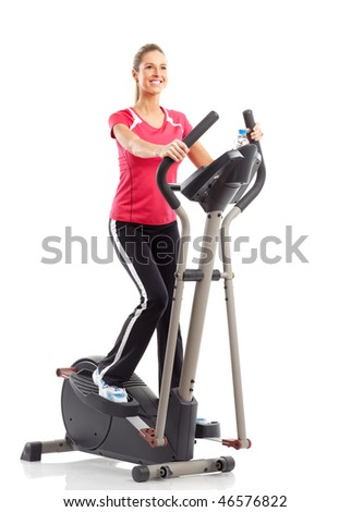 Gym & Fitness. Smiling young woman working out. Isolated over white background - stock photo