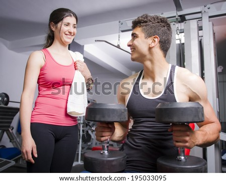 Gym friends taking a conversation at old gym. - stock photo