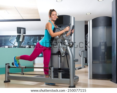 Gym glute exercise machine woman workout indoor - stock photo
