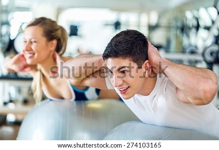 Gym. Group of people exercising at the gym - stock photo