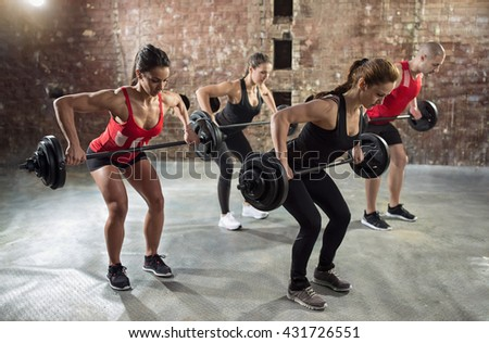 gym group with weight lifting workout body pump - stock photo