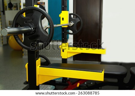 Gym. Gymnasium with sports equipment. Barbells, dumbbells - equipment to work on muscle mass. Fitness club weight training equipment gym. Barbell ready to workout, indoors, shallow - stock photo