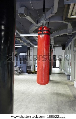 Gym interior with punching bags - stock photo