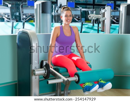 Gym leg extension exercise workout woman indoor - stock photo