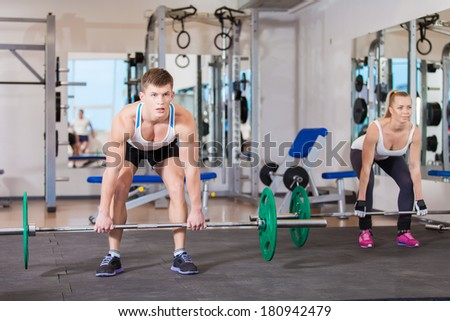Gym man and woman push-up strength in a fitness workout - stock photo