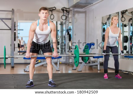 Gym man and woman push-up strength in a fitness workout