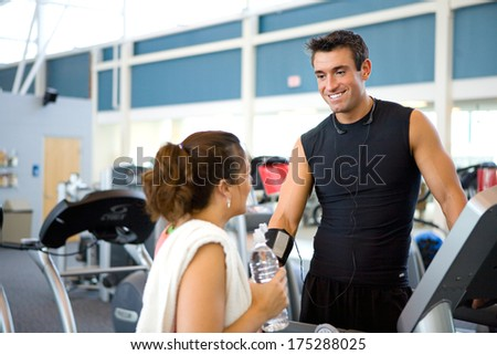 Gym: Man Flirting With Woman While at Gym - stock photo