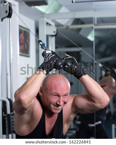 Gym Man. Man with weight training equipment on sport gym club