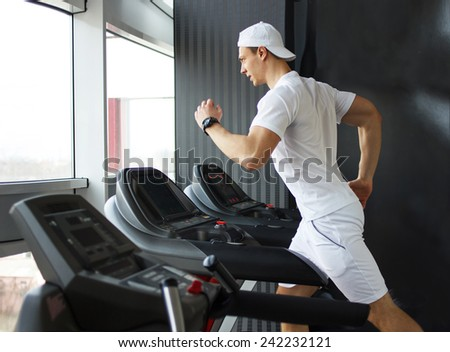 gym man running on the treadmill - stock photo