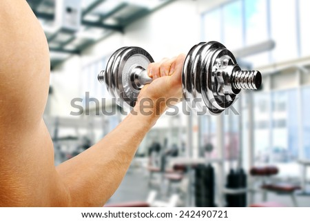 gym. man with dumbbell in the hand - stock photo