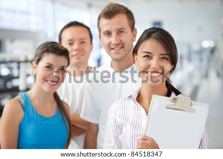Gym manager showing the facilities to a group of people - stock photo