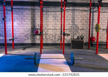 Gym nobody with barbells kettlebells bars and weightlifting gear - stock photo